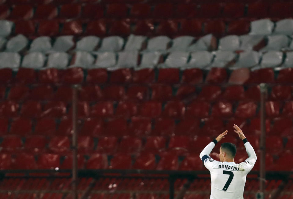 Portugal's Cristiano Ronaldo wearing his captain's armband reacts during the World Cup 2022 group A qualifying soccer match against Serbia at the Rajko Mitic stadium in Belgrade, Serbia, Saturday, March 27, 2021. The captain's armband which Cristiano Ronaldo threw to the pitch after his overtime winning goal was disallowed in a World Cup qualifier against Serbia has been put on auction Tuesday March 30, 2021. The armband is being auctioned by a charity group raising money for surgery of a six-month-old boy from Serbia suffering spinal muscular atrophy. (AP Photo/Darko Vojinovic)