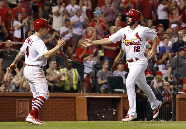 St. Louis Cardinals' Paul DeJong (12) and Tyler O'Neill celebrate after scoring on a double by Kolten Wong during the eighth inning of a baseball game against the Milwaukee Brewers on Friday, Aug. 17, 2018, in St. Louis. (AP Photo/Jeff Roberson)