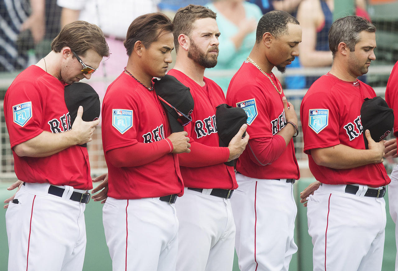 <p>Boston Red Sox players stop for a moment of silence honoring the victims of the shooting at Marjory Stoneman Douglas High School last week, prior to their spring training game against the Minnesota Twins at JetBlue Park in Flort Myers, Fla., on Feb. 23, 2018. (Photo: Kinfay Moroti/The News-Press via USA TODAY NETWORK/Reuters) </p>