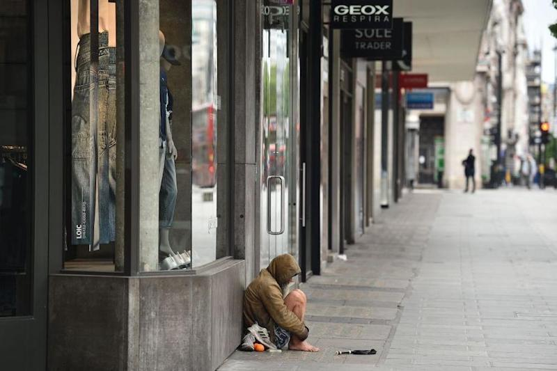 A homeless person is seen on Oxford Street in central London in May this year: AFP via Getty Images