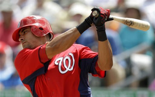 Washington Nationals' Ian Desmond strikes out swinging in the first inning of a spring training baseball game against the Miami Marlins in Jupiter, Fla., Tuesday, March 27, 2012. Miami won 3-1. (AP Photo/Patrick Semansky)