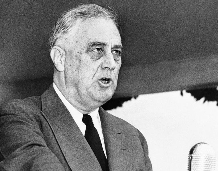 """FILE - In this April 13, 1943 black-and-white file photo, President Franklin Delano Roosevelt speaks in Washington.  Sen. Elizabeth Warren's plan to pay for """"Medicare for All"""" without raising middle-class taxes departs from the shared responsibility the U.S. traditionally has required for bedrock programs.  That's different from the """"social insurance"""" idea of Democratic presidents like Franklin D. Roosevelt, Harry Truman and Lyndon Baines Johnson. They relied on broad-based taxes packaged as """"contributions,"""" fostering a sense of ownership.   (AP Photo/Robert Clover, File)"""