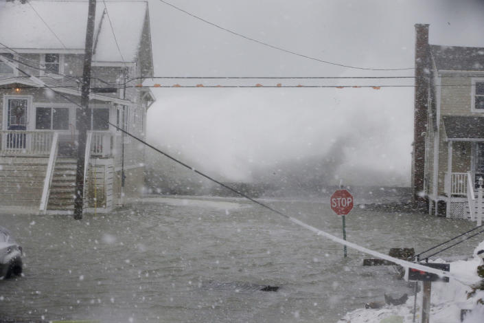 <p>An Atlantic Ocean wave crashes into the seawall between two houses on Ocean Avenue Thursday, Jan. 4, 2018, in Scituate, Mass. The National Weather Service has issued a blizzard warning for Thursday that extends from eastern Long Island north to coastal New Hampshire and Maine. Most of the rest of southern New England is under a winter storm watch. (Photo: Stephan Savoia/AP) </p>