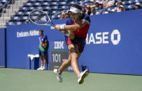 Bianca Andreescu, of Canada, returns a shot to Greet Minnen, of Belgium, during the third round of the US Open tennis championships, Saturday, Sept. 4, 2021, in New York. (AP Photo/Seth Wenig)