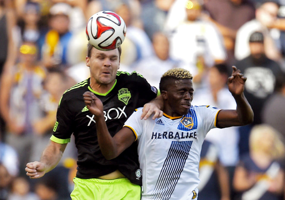 Seattle Sounders FC defender Chad Marshall, left, and Los Angeles Galaxy forward Gyasi Zardes try to head the ball during the first half of a Major League Soccer playoff game, Sunday, Nov. 23, 2014, in Carson, Calif. (AP Photo/Mark J. Terrill)