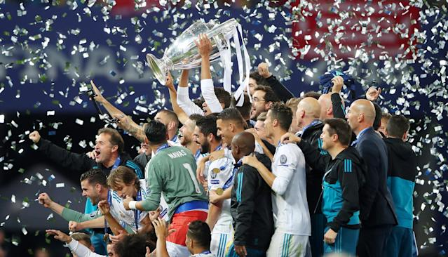 Soccer Football - Champions League Final - Real Madrid v Liverpool - NSC Olympic Stadium, Kiev, Ukraine - May 26, 2018 Real Madrid celebrate winning the Champions League with the trophy REUTERS/Hannah McKay