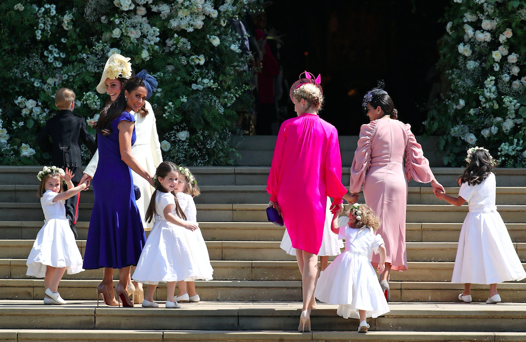 Princess Charlotte, far left, gives a wave to the crowd on her way into the chapel with her mother, the Duchess of Cambridge (Picture: Rex)