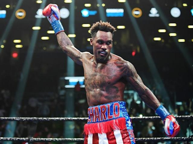 Unbeaten American Jermall Charlo celebrates his seventh round technical knockout of Ireland's Dennis Hogan in a WBC middleweight world title fight (AFP Photo/Emilee Chinn)