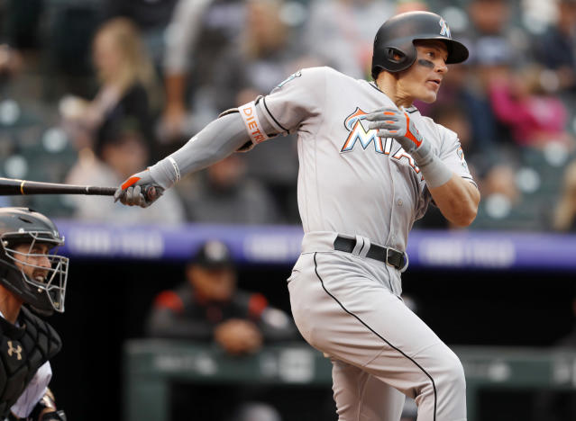 Miami Marlins' Derek Dietrich follows the flight of his single off Colorado Rockies starting pitcher German Marquez in the third inning of a baseball game Sunday, June 24, 2018, in Denver. (AP Photo/David Zalubowski)