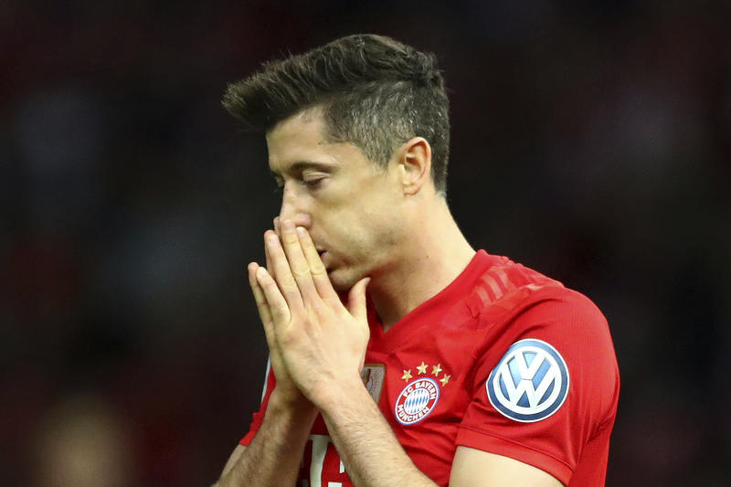 Bayern's Robert Lewandowski reacts during the German soccer cup, DFB Pokal, final match between RB Leipzig and Bayern Munich at the Olympic stadium in Berlin, Germany, Saturday, May 25, 2019. (AP Photo/Matthias Schrader)