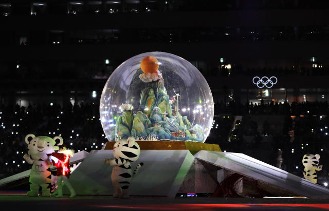<p>Olympic mascots stand by a snow globe during the closing ceremony of the 2018 Winter Olympics in Pyeongchang, South Korea, Sunday, Feb. 25, 2018. (AP Photo/Kirsty Wigglesworth) </p>