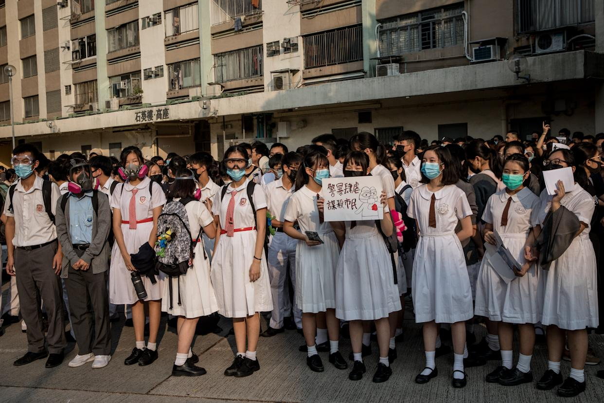 Schoolmates of a protester who was shot by a policeman during the October 1 protests, take part in a solidarity rally outside the Tsuen Wan Public Ho Chuen Yiu Memorial College on October 02, 2019 in Hong Kong, China. | Chris McGrath—Getty Images
