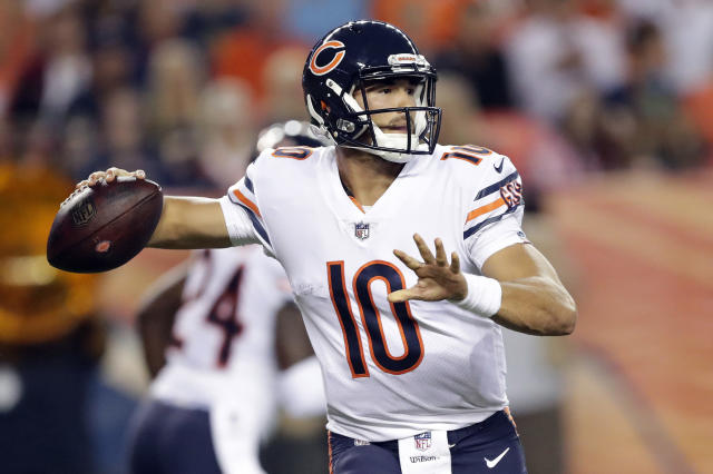 FILE - In this Aug. 18, 2018, file photo, Chicago Bears quarterback Mitchell Trubisky (10) throws against the Denver Broncos during the first half of a preseason NFL football game, in Denver. The Bears spent the offseason loading up around Trubisky, hoping to accelerate their prized quarterbacks development and energize a franchise with four straight last-place finishes in the NFC North. (AP Photo/Jack Dempsey, File)
