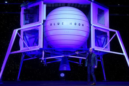 Founder Chairman CEO and President of Amazon Jeff Bezos unveils his space company Blue Origin's space exploration lunar lander rocket called Blue Moon during an unveiling event in Washington