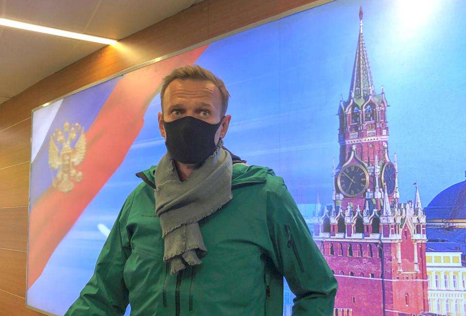 Russian opposition leader Alexei Navalny speaks with journalists upon the arrival at Sheremetyevo airport in Moscow, Russia January 17, 2021. / Credit: STAFF / REUTERS