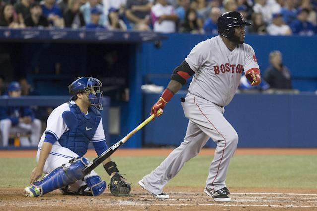 Boston Red Sox's David Ortiz, right, and Toronto Blue Jays catcher Dioner Navarro watch the flight of the ball after the Red Sox designated hitter hits a RBI single during sixth inning American League baseball action in Toronto on Wednesday, Aug. 27, 2014. (AP Photo/The Canadian Press, Chris Young)