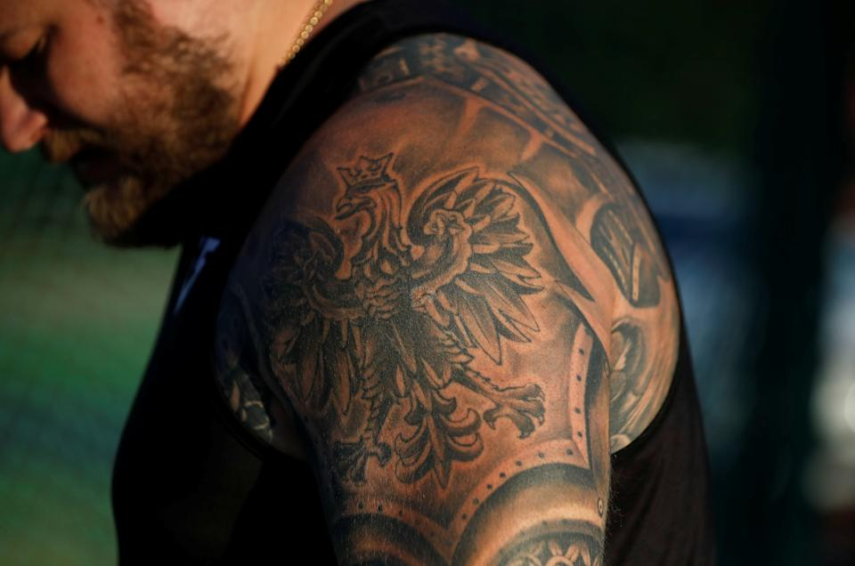 <p>Poland's hammer thrower Pawel Fajdek's tattoo, with the Polish emblem on his arm, is pictured during his training ahead of the Tokyo 2020 Olympics, at the stadium in Poznan, Poland June 28, 2021. Picture taken June 28, 2021. REUTERS/Kacper Pempel</p>