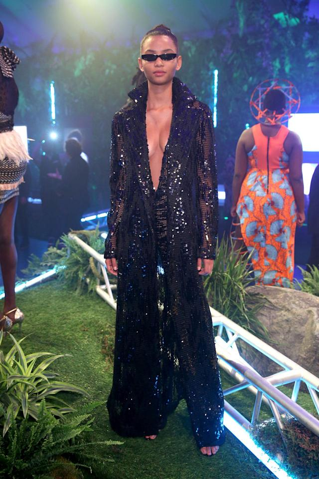 <p>Model wears a black sequin robe and jumpsuit designed by LaQuan Smith at the Black Panther Welcome to Wakanda NYFW fashion presentation. (Photo: Courtesy of Marvel Studios Black Panther/Getty) </p>
