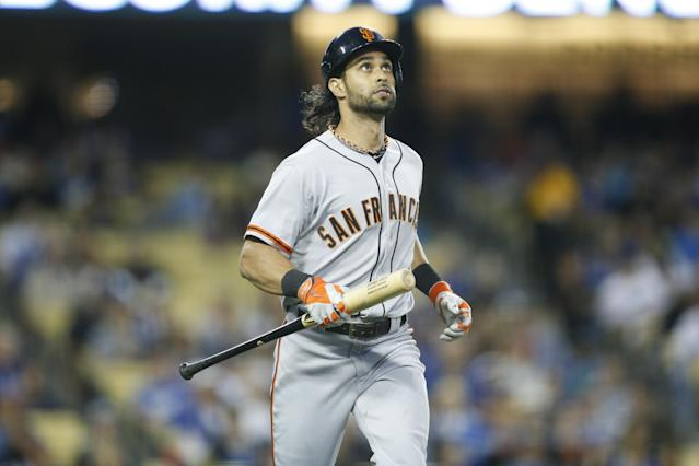 San Francisco Giants' Angel Pagan runs with his bat as he flies out against the Los Angeles Dodgers during a baseball game, Friday, May 9, 2014, in Los Angeles. The Giants won 3-1. (AP Photo/Danny Moloshok)