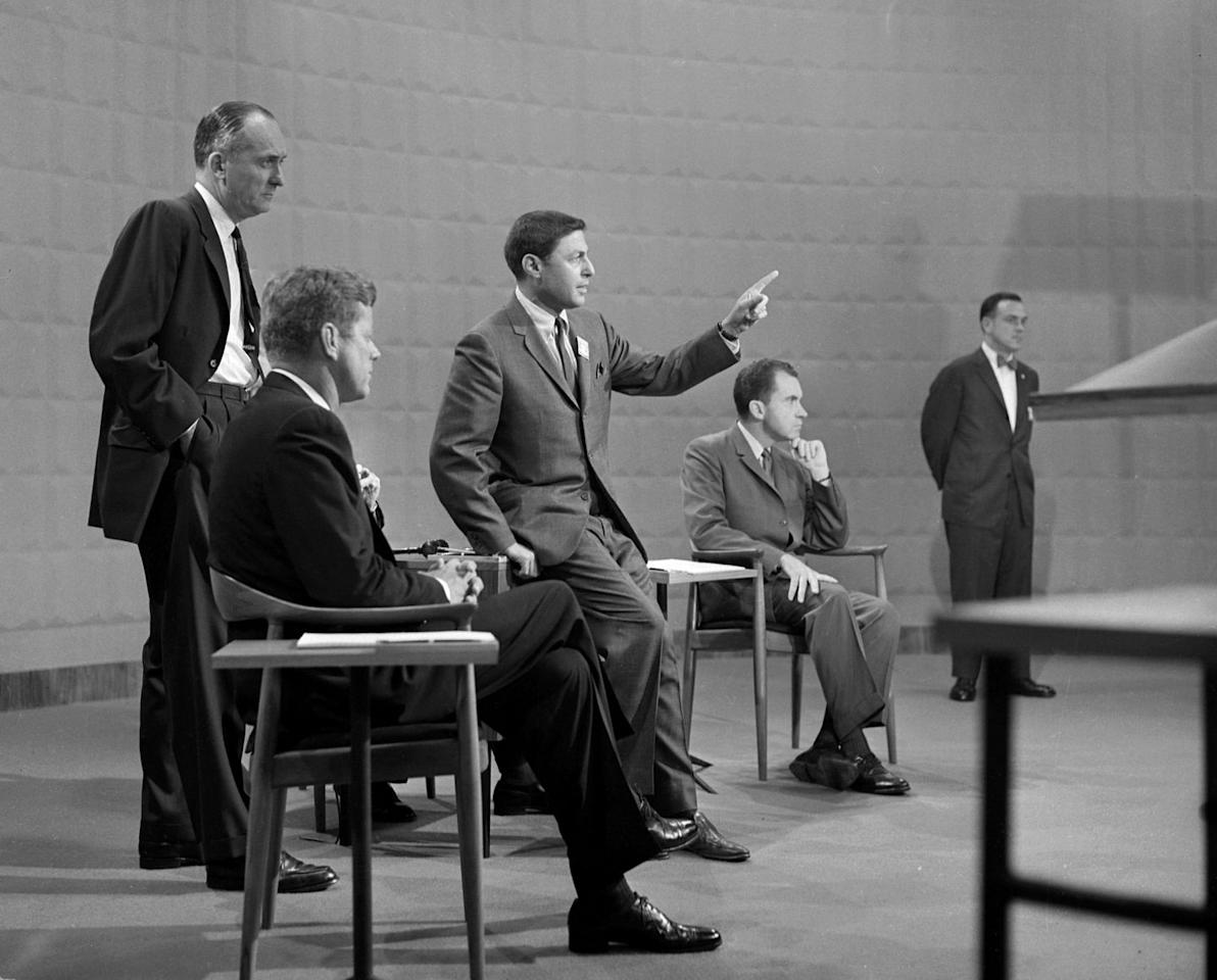 <p>Kennedy and Nixon sit in their respective chairs, while getting instructions about the broadcast from CBS news producer Don Hewitt. </p>