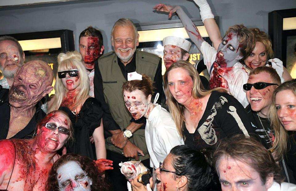 """<span class=""""caption"""">Filmmaker George Romero at the premiere of 'Survival of the Dead' in 2010. </span> <span class=""""attribution""""><a class=""""link rapid-noclick-resp"""" href=""""https://www.gettyimages.com/detail/news-photo/director-george-a-romero-and-zombies-attend-the-premiere-of-news-photo/99605569"""" rel=""""nofollow noopener"""" target=""""_blank"""" data-ylk=""""slk:Ben Hider/Getty Images""""> Ben Hider/Getty Images</a></span>"""