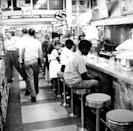 "<p>Due to segregation and Jim Crow laws, it was illegal for Black people to sit at the counters in many shops until 1964. Here, a sit-in takes place in Oklahoma City on August 26, 1958 to desegregate lunch counters. Many similar protests took place during the <a href=""https://www.history.com/topics/black-history/civil-rights-movement"" rel=""nofollow noopener"" target=""_blank"" data-ylk=""slk:Civil Rights Movement"" class=""link rapid-noclick-resp"">Civil Rights Movement</a>.</p>"