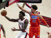 Portland Trail Blazers forward Nassir Little, left, shoots in front of Oklahoma City Thunder forward Isaiah Roby during the first half of an NBA basketball game in Portland, Ore., Monday, Jan. 25, 2021. (AP Photo/Craig Mitchelldyer)