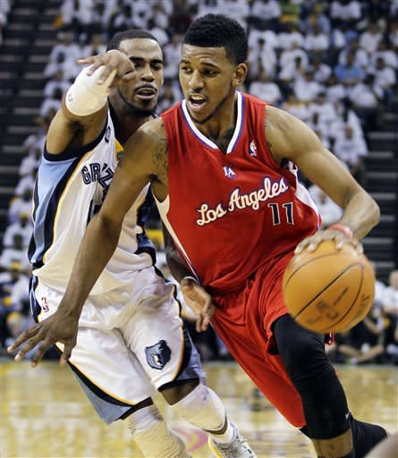 Los Angeles Clippers' Nick Young (11) moves the ball around Memphis Grizzlies' Mike Conley during the first half in Game 1 of a first-round NBA basketball playoff series, Sunday, April 29, 2012, in Memphis, Tenn. (AP Photo/Danny Johnston)