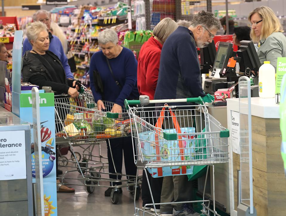 Woolworths opens it doors in Melbourne from 7am to 8am for the elderly to do their shopping during the virus pandemic. Source: AAP