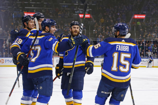 St. Louis Blues' Jay Bouwmeester (19) is congratulated by teammates Colton Parayko (55), David Perron (57), Ryan O'Reilly (90) and Robby Fabbri (15) after scoring a goal during the second period of an NHL hockey game against the Montreal Canadiens Thursday, Jan. 10, 2019, in St. Louis. (AP Photo/Billy Hurst)