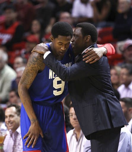 New Jersey Nets' MarShon Brooks (9) talks to head coach Avery Johnson during the first half of an NBA basketball game against the Miami Heat, Tuesday, March 6, 2012,in Miami. (AP Photo/J Pat Carter)