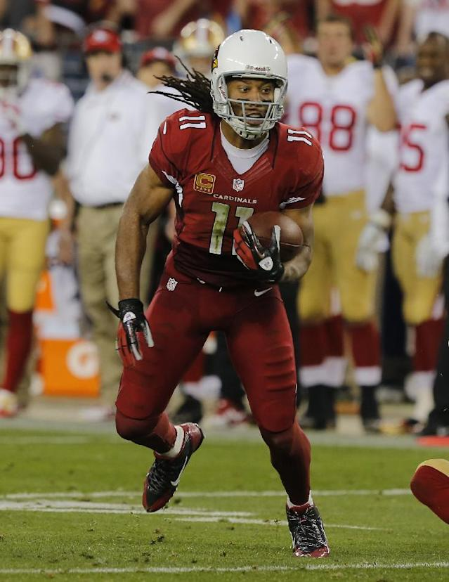 Arizona Cardinals wide receiver Larry Fitzgerald (11) against the San Francisco 49ers during the first half of an NFL football game, Sunday, Dec. 29, 2013, in Glendale, Ariz. (AP Photo/Rick Scuteri)