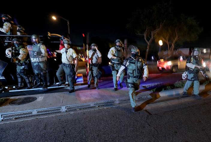 WEST HOLLYWOOD, CA - SEPT. 25, 2020. Los Angeles County Sheriff's Department deputies deploy to disperse Black Lives Matter protesters marching in West Hollywwod on Friday night, Sept. 25, 2020, calling for justice for Breonna Taylor. (Luis Sinco / Los Angeles Times)