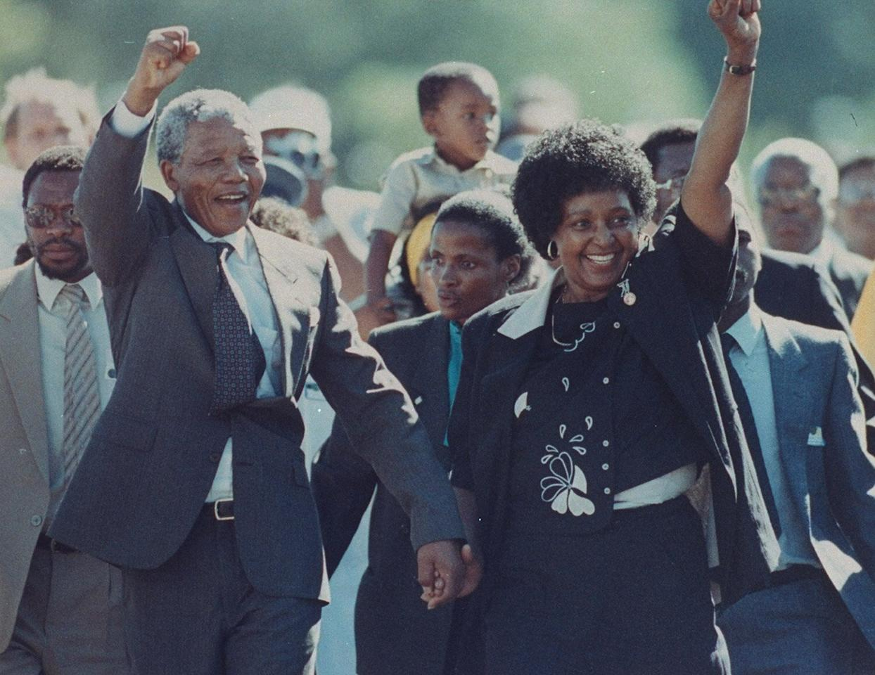 """The anti-apartheid South African revolutionary is seen with his then-wife Winnie raising his fist upon his release from Victor Verster prison after being jailed for 27 years.  Four years later, he was inaugurated as South Africa's first democratically elected president and served one term before focusing on his philanthropic work for the <a href=""""https://www.nelsonmandelachildrensfund.com/"""">Nelson Mandela Children's Fund</a>, the <a href=""""https://www.nelsonmandela.org/"""">Nelson Mandela Foundation</a> and <a href=""""https://mandelarhodes.org/"""">The Mandela Rhodes Foundation</a>.  Mandela died in 2013 and is remembered for his relentless fight for equality, work to combat poverty, HIV and AIDs. He's received over 200 honors, including the Nobel Peace Prize (1993), Amnesty International's Ambassador of Conscience Award (2006), Presidential Medal of Freedom (2002) and the Olympic Gold Order (1994)."""