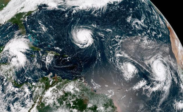 A NOAA satellite image showing Hurricanes Florence, Isaac and Helene, which is due to hit the UK on Monday night or Tuesday morning