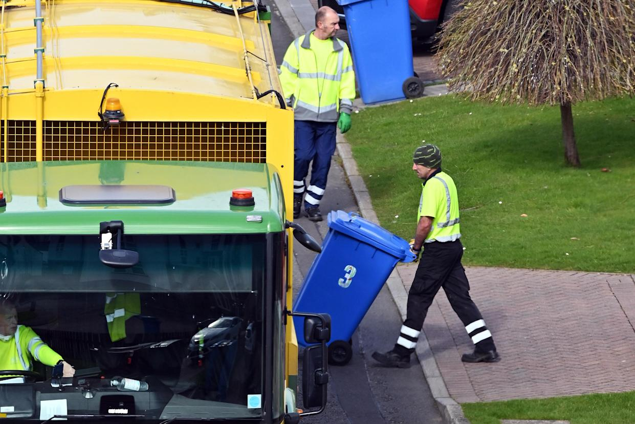 DALGETY BAY, FIFE - MARCH 30: A kerbside bin collection still under way in a suburban street as councils cut back on collections and close recycling centres in response to the coronavirus pandemic, on March 30, 2020 in Dalgety Bay, Fife. (Photo by Ken Jack/Getty Images)