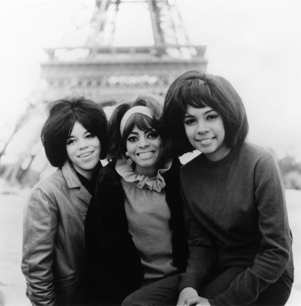<p>Mary Wilson, Florence Ballard, and Diana Ross look radiant posing in front of the Eiffel Tower in 1960. Talk about a <em>supreme </em>view.</p>