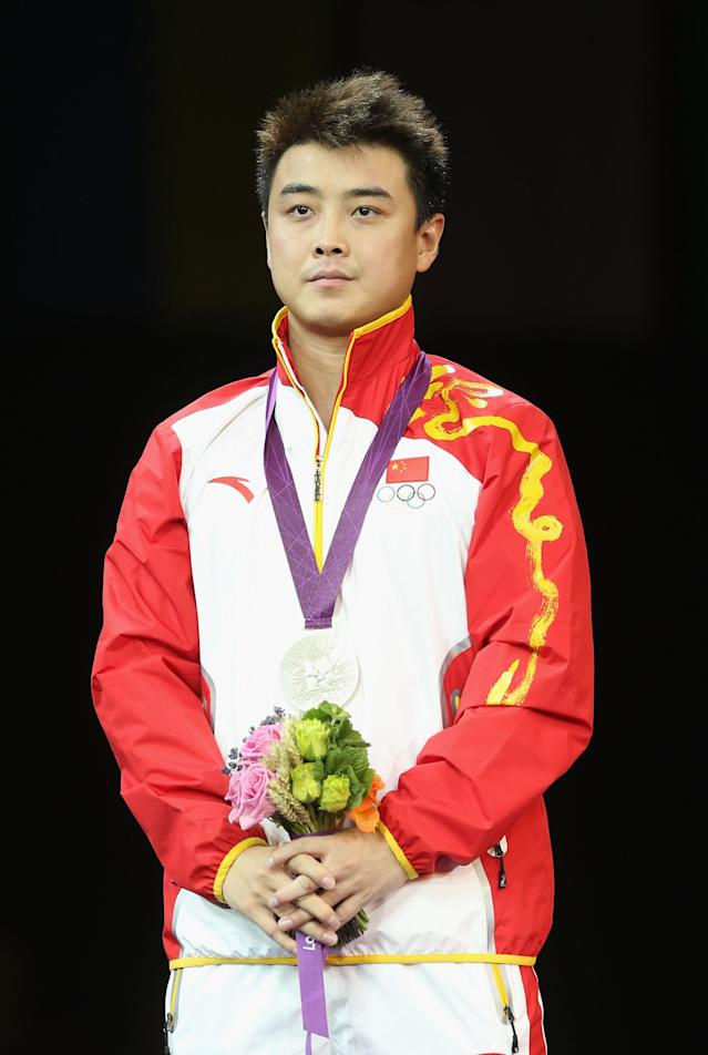 LONDON, ENGLAND - AUGUST 02: Silver medalist Wang Hao of China poses on the podium during the medal ceremony during the medal ceremony for the Men's Singles Table Tennis on Day 6 of the London 2012 Olympic Games at ExCeL on August 2, 2012 in London, England. (Photo by Feng Li/Getty Images)