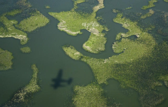 A Cajun Air seaplane travels over the marsh as the search continues for the missing Seacor Power crew members, near Lake Pelto in Terrebonne Parish, La., on Thursday, April 29, 2021. Nineteen people were on the Seacor Power when it capsized April 13. Six people were rescued and six bodies have been recovered. (Sophia Germer/The Advocate via AP)