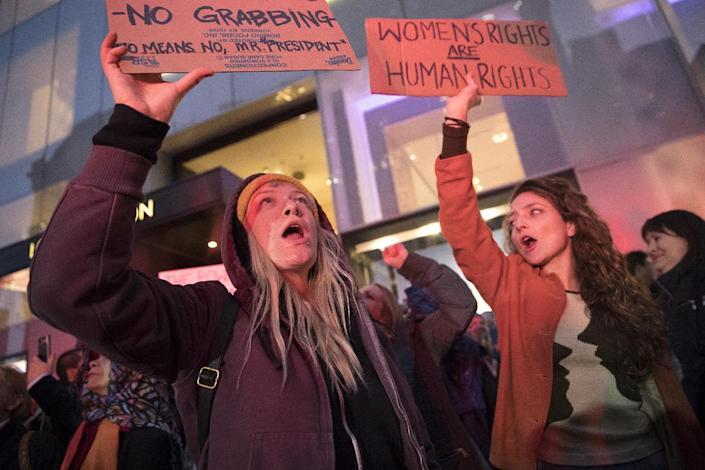 <p>Demonstrators hold signs during a rally outside Trump Tower in New York on Saturday, Nov. 12, 2016, to protest against President-elect Donald Trump. (AP Photo/Mary Altaffer) </p>