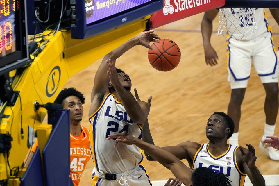 LSU guard Cameron Thomas (24) battles under the basket with Tennessee guard Keon Johnson (45) in the second half of an NCAA college basketball game in Baton Rouge, La., Saturday, Feb. 13, 2021. (AP Photo/Gerald Herbert)