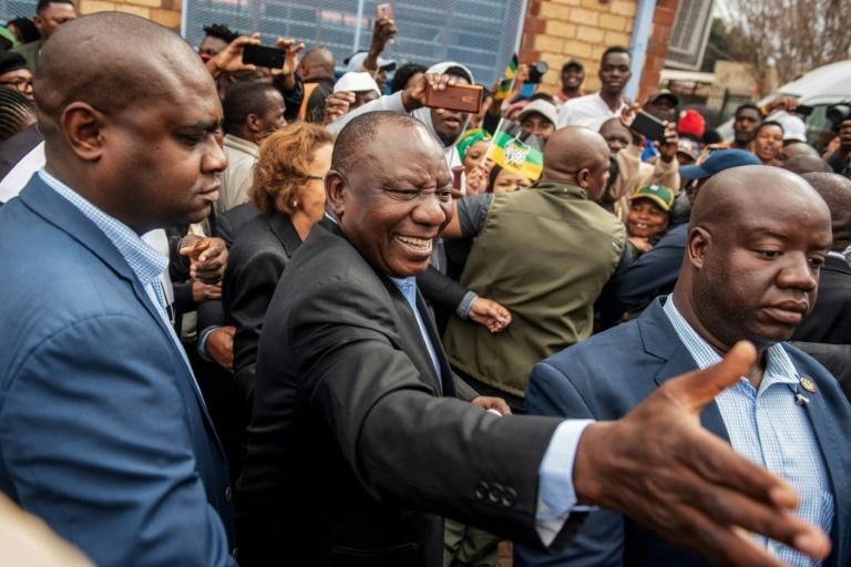 Ramaphosa, pictured as he arrived to cast his vote in Soweto on May 8, faces a struggle between factions within the ANC