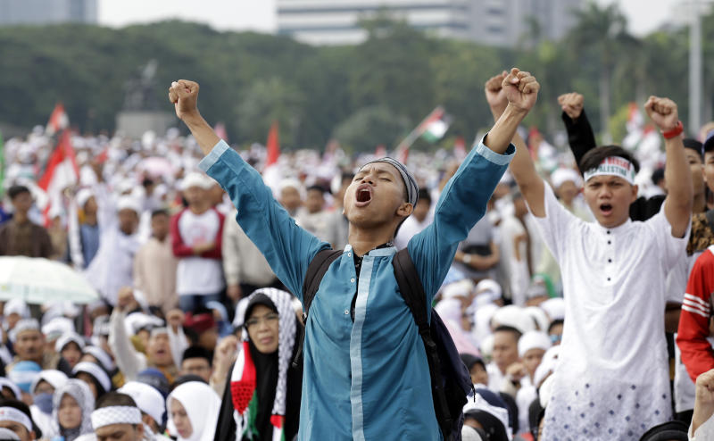 Protesters shout slogans during a rally against U.S. President Donald Trump's recognition of Jerusalem as Israel's capital at Monas, the national monument, in Jakarta, Indonesia, Sunday, Dec. 17, 2017. (AP Photo/Achmad Ibrahim)