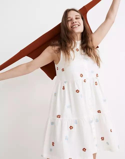 <p><span>Daisy Embroidered Banded-Collar Tiered Dress</span> ($70, originally $98)</p>