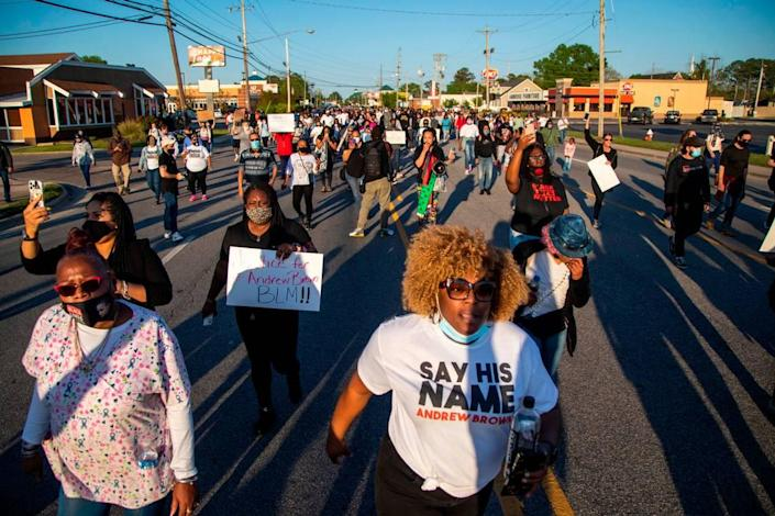 Demonstrators march peacefully in Elizabeth City on Monday April 26, 2021 after family viewed 20 seconds of police body camera video of the shooting death of Andrew Brown Jr.