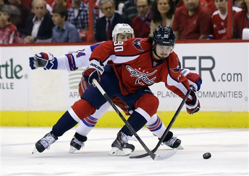 New York Rangers right wing Ryan Callahan guards Washington Capitals center Marcus Johansson (90), from Sweden, in the first period of Game 5 first-round NHL Stanley Cup playoff hockey series, Friday, May 10, 2013, in Washington. (AP Photo/Alex Brandon)