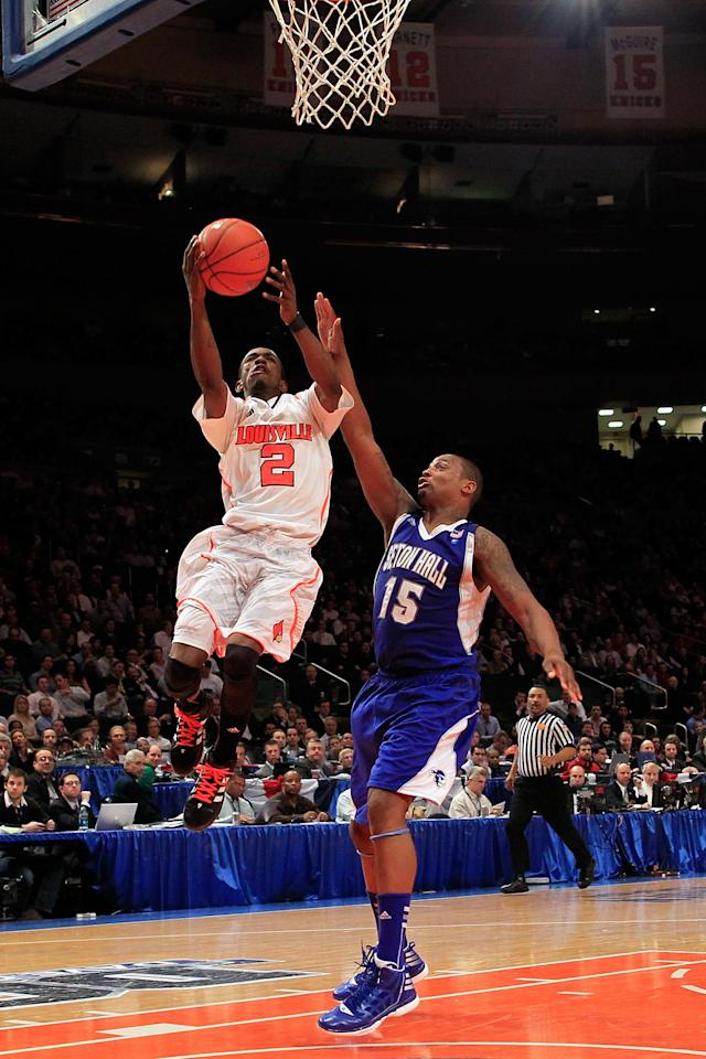 NEW YORK, NY - MARCH 07: Russ Smith #2 of the Louisville Cardinals goes to the basket against Herb Pope #15 of the Seton Hall Pirates during their second round game of the Big East Men's Basketball Tournament at Madison Square Garden on March 7, 2012 in New York City. (Photo by Chris Trotman/Getty Images)