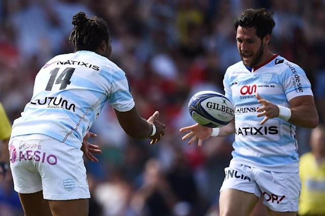 All yours: Teddy Thomas passes the ball to scrum-half Maxime Machenaud for the third try (AFP Photo/NICOLAS TUCAT)