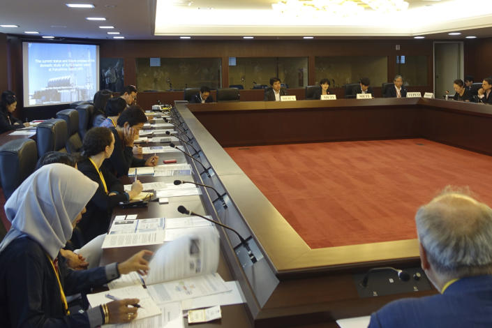 Diplomats from 22 countries attend a briefing on the Fukushima nuclear plant's safety at the foreign ministry in Tokyo, Wednesday, Sept. 4, 2019. Japan has reassured foreign diplomats about the crippled nuclear plant's safety amid concerns about massive amounts of treated but radioactive water stored in tanks. (AP Photo/Mari Yamaguchi)