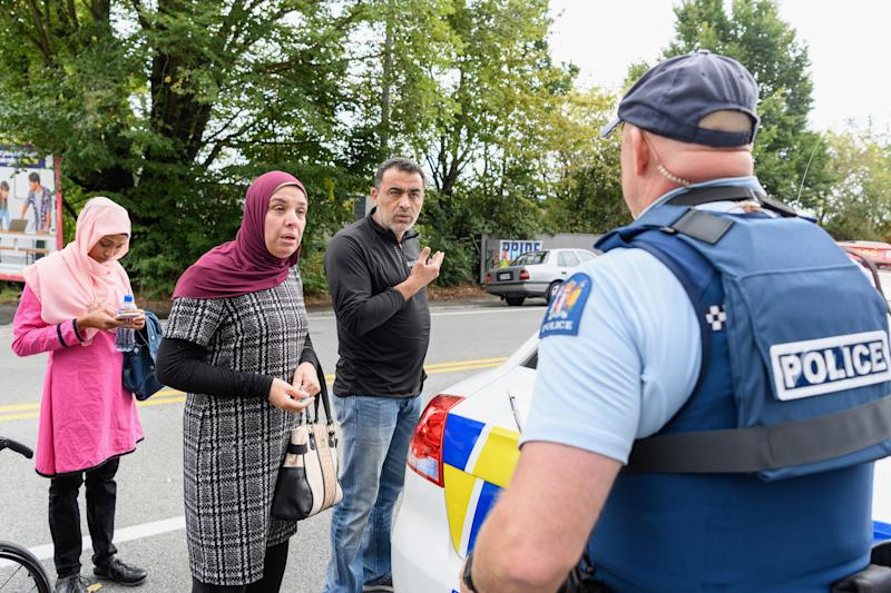 People concerned about the fate of their relatives talk to police outside the Al Noor mosque in Christchurch, New Zealand, on March 15, 2019.  (Photo: Kai Schwoerer via Getty Images)